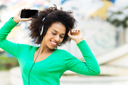woman listening to music: Afro-American woman listening to music