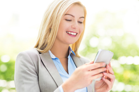 woman on cell phone: Woman text messaging Stock Photo