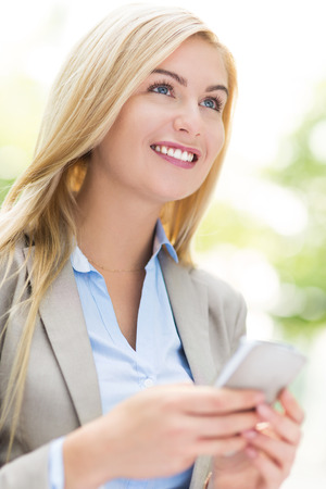 Businesswoman using a mobile phone photo