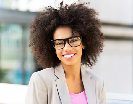 Young businesswoman with afro hair photo