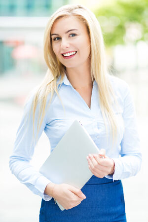 Young businesswoman outdoors photo