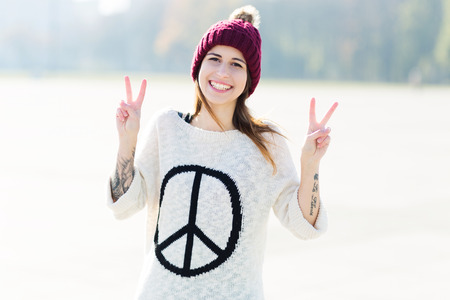wolly: Girl showing peace sign
