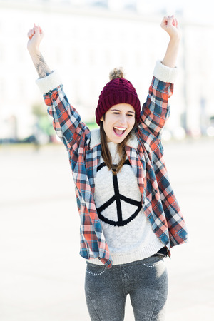 wolly: Girl wearing a sweater with peace sign Stock Photo