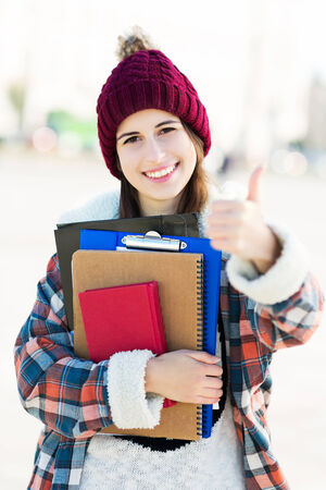 wolly: Female student holding books Stock Photo