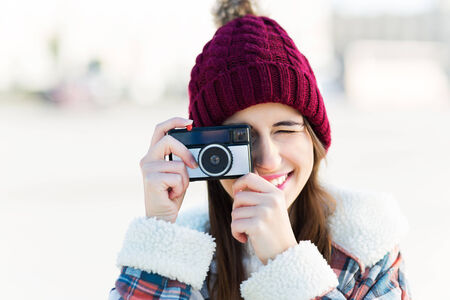 Woman using vintage camera photo