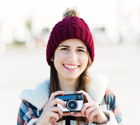 wolly: Young woman with vintage camera