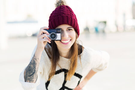 wolly: Woman using vintage camera