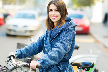 Young woman on bike photo