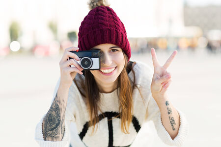 wolly: Teenage girl using vintage camera Stock Photo