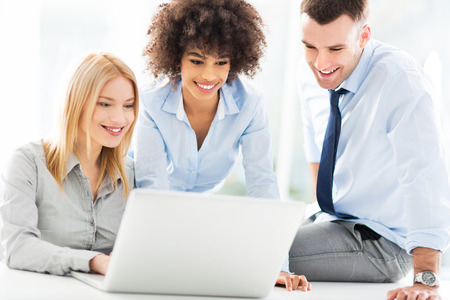 group business: Business people using laptop together Stock Photo