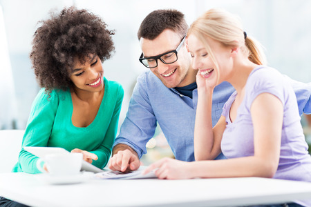 casual: Creative professionals discussing in office Stock Photo
