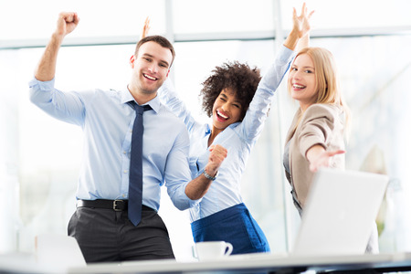 manager office: Business people cheering with arms raised Stock Photo