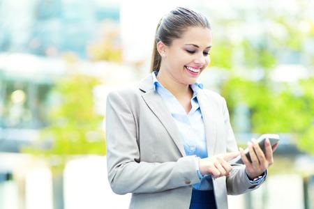 text messaging: Woman text messaging Stock Photo