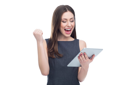 woman white background: Excited woman with digital tablet