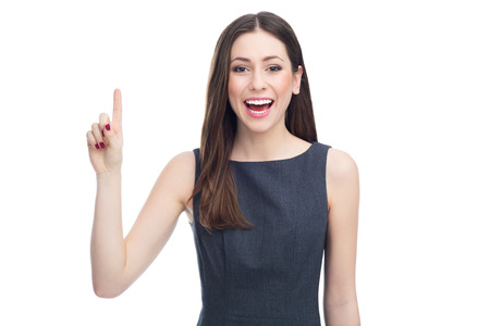 pointing finger up: Attractive woman pointing up Stock Photo