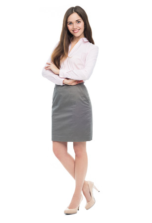 isolatedrn: Portrait of young business woman standing with arms crossed Stock Photo