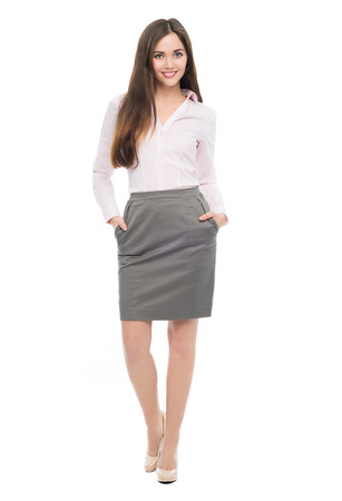 isolatedrn: Full length of young businesswoman standing Stock Photo