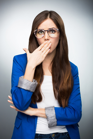 covering mouth: Woman covering mouth