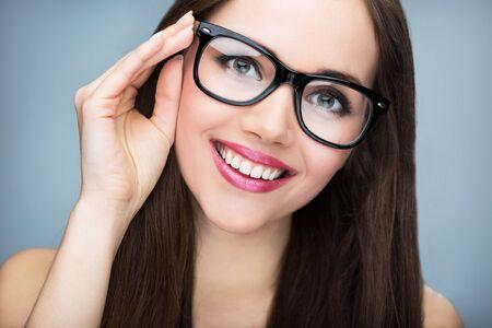 optician: Beautiful woman wearing glasses Stock Photo