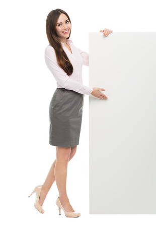 Woman standing next to big white poster Imagens