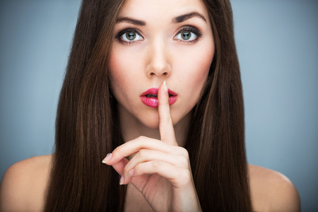 natural make up: Woman making silence gesture
