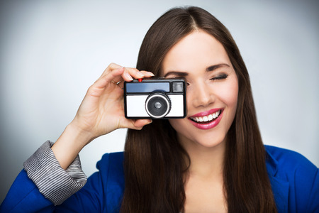 Beautiful woman with vintage camera photo