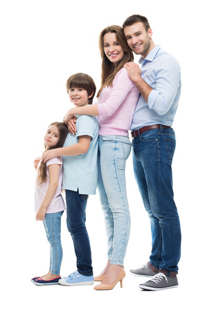 Young family with two children standing together Standard-Bild