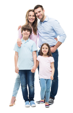people laughing: Young family with two children standing together Stock Photo
