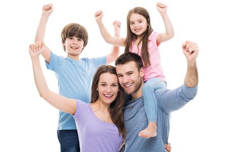 Familia emocionada con los brazos alzados Foto de archivo