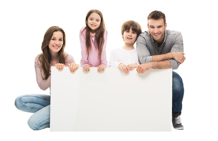 a placard: Family with banner Stock Photo