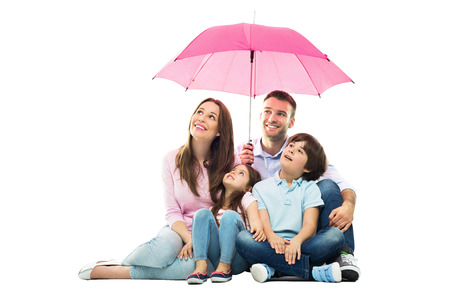 protect family: Family with the umbrella