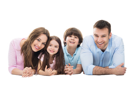 young man smiling: Happy family with two kids Stock Photo