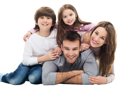 smiling young man: Happy family with two kids Stock Photo