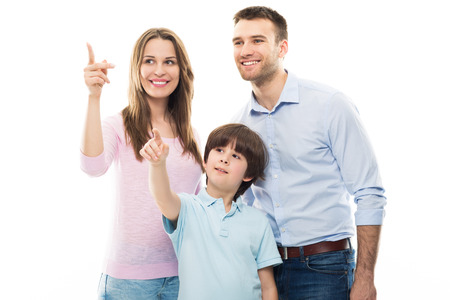 happy people white background: Family pointing up Stock Photo
