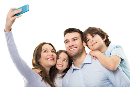 group photo: Family taking photo of themselves Stock Photo