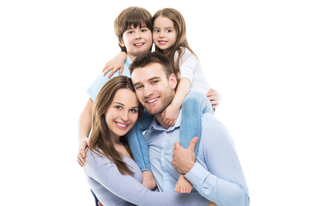 happy girls: Young family with two kids Stock Photo