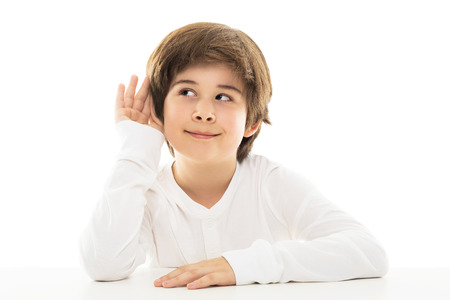 listening ear: Boy with a hand a listening ear in a gesture Stock Photo