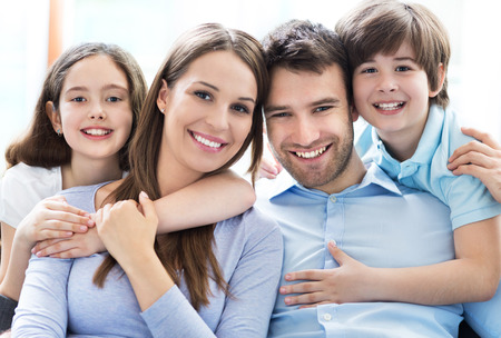kids having fun: Young family with two kids Stock Photo
