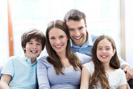 family sofa: Happy family at home Stock Photo