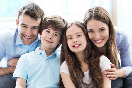 home  life: Happy family at home Stock Photo