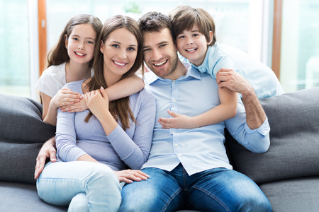 family in living room: Happy family at home Stock Photo