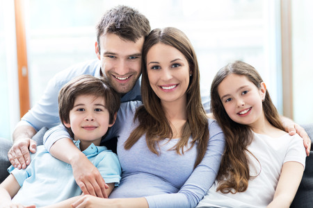 husbands and wives: Happy family at home Stock Photo