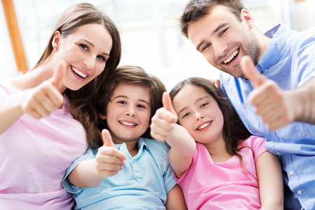Family with thumbs up