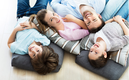 Happy family together on the floor