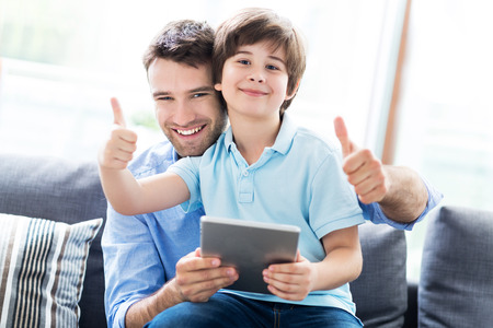 internet love: Father and son using digital tablet Stock Photo
