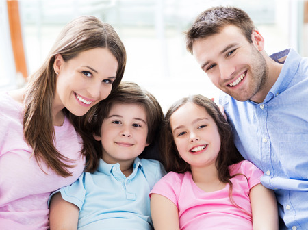 family with two children: Happy family at home Stock Photo
