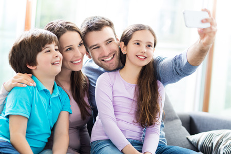 Family taking photo of themselves 스톡 콘텐츠