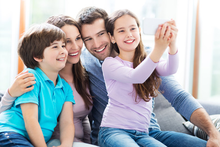 taking a wife: Family taking photo of themselves Stock Photo