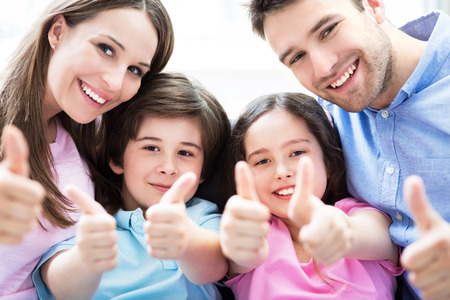 Family showing thumbs up Stock Photo