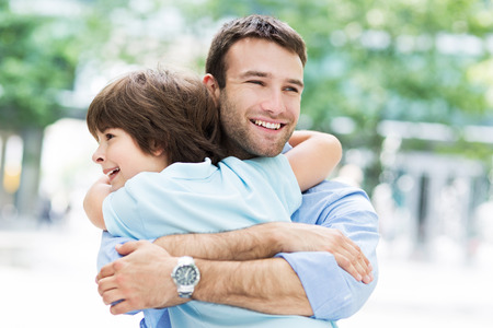 father with children: Father and son hugging Stock Photo